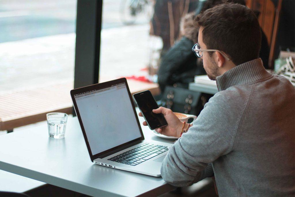 A man reading a Stirr Creativ Blog on SEO in Portland
