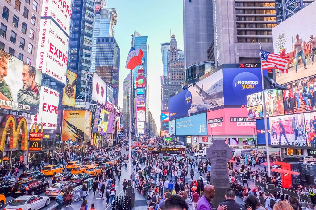A colorful wide shot of Times Square in New York City